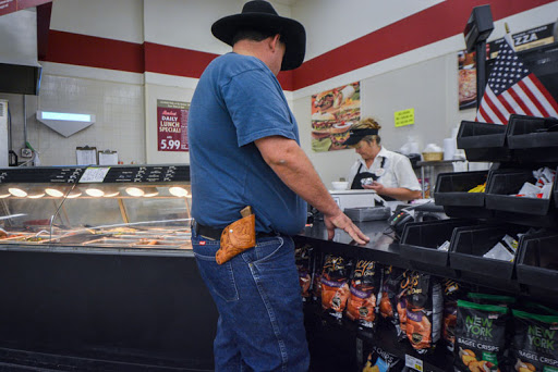 Across the nation, guns can be carried into more public places